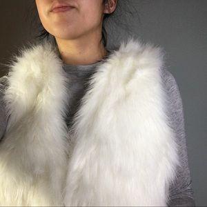 White faux fur vest